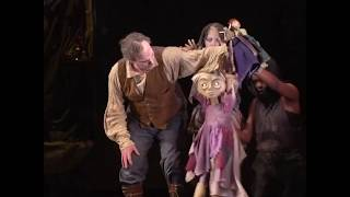 How is puppetry used in The Grinning Man?
