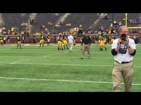 Tom Brady playing catch with Tom Brady before Michigan's game