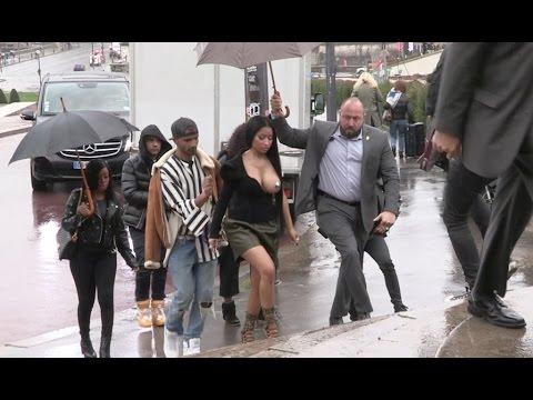 EXCLUSIVE - Nicki Minaj arrives at Haider Ackermann Fashion Show wearing only pasties