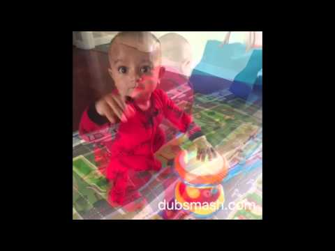 9 month old dancing on Baby doll