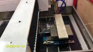 Gambar cover CCHS (HackerSpace) 3 Axis CNC mill cutting a project box out of aluminium
