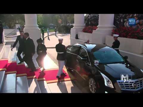 Tanzania President Jakaya Kikwete and spouse Salma Kikwete arrive at the White House Diner