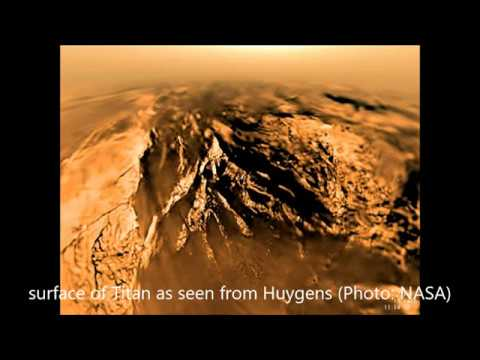 Saturn Moon Titan with lakes seas and a dense atmosphere