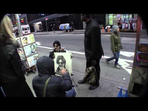 Banksy getting portrait drawn in Times Square NYC