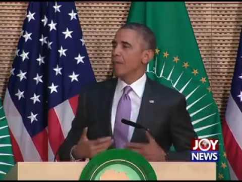 Obama telling off Mugabe