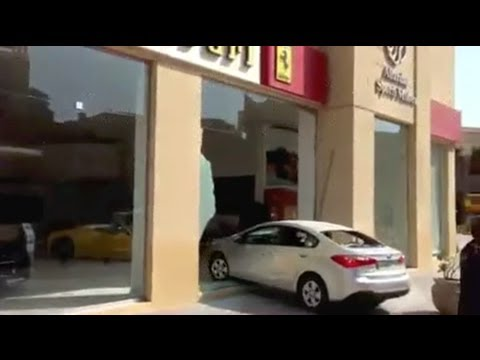 Drunk driver crashes into Ferrari Showroom and escapes!