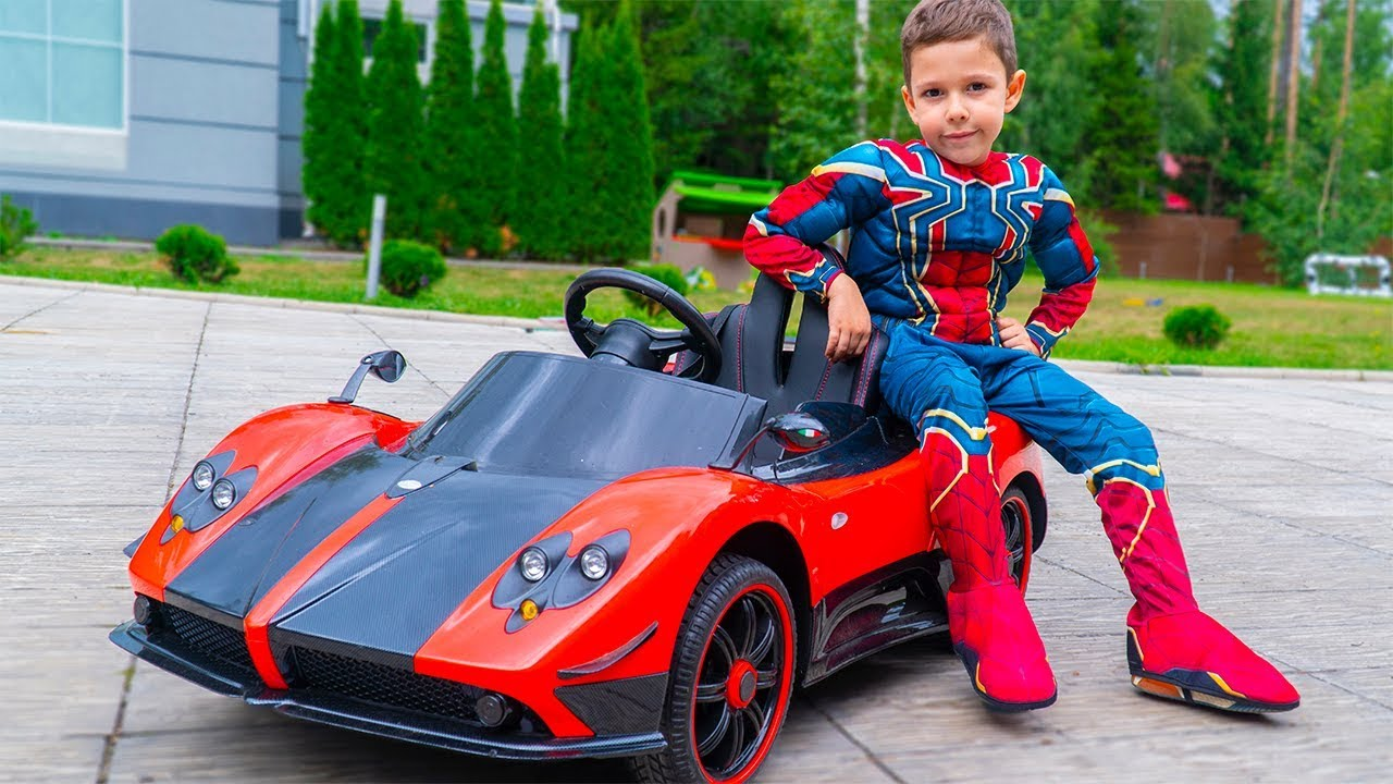 Artem chooses toy cars for Superheroes