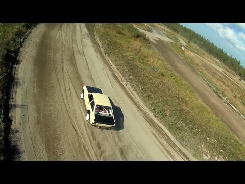 FPV roll practices and car chasing at a rallycross track