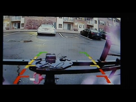 Aftermarket backup camera with integrated video in mirror installation