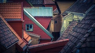 Exploring a little maze of wooden red houses - that is Bryggen in Norway