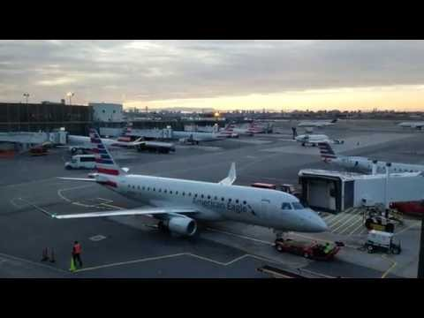 American Eagle Embraer E175 pushed from gate at LaGuardia Airport