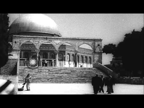 Israeli Arabs pray at a mosque in Jerusalem and reunite with their families. HD Stock Footage