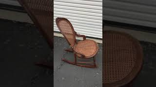 Small antique cane and wood rocking chair