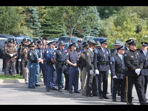 Trooper Paul Butterfield's funeral Last people enter Manistee High School