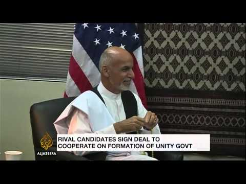 Afghan poll rivals sign unity government deal