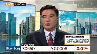 China's Economy Has Seen Some Pressure From Trade War, Says CCIEE CEO