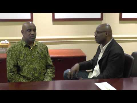 Dr. Fritz Pinnock tells about his childhood to interviewer L