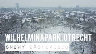 4K VIDEO OF DJI MAVIC PRO DRONE FLYING IN A SNOWY PARC