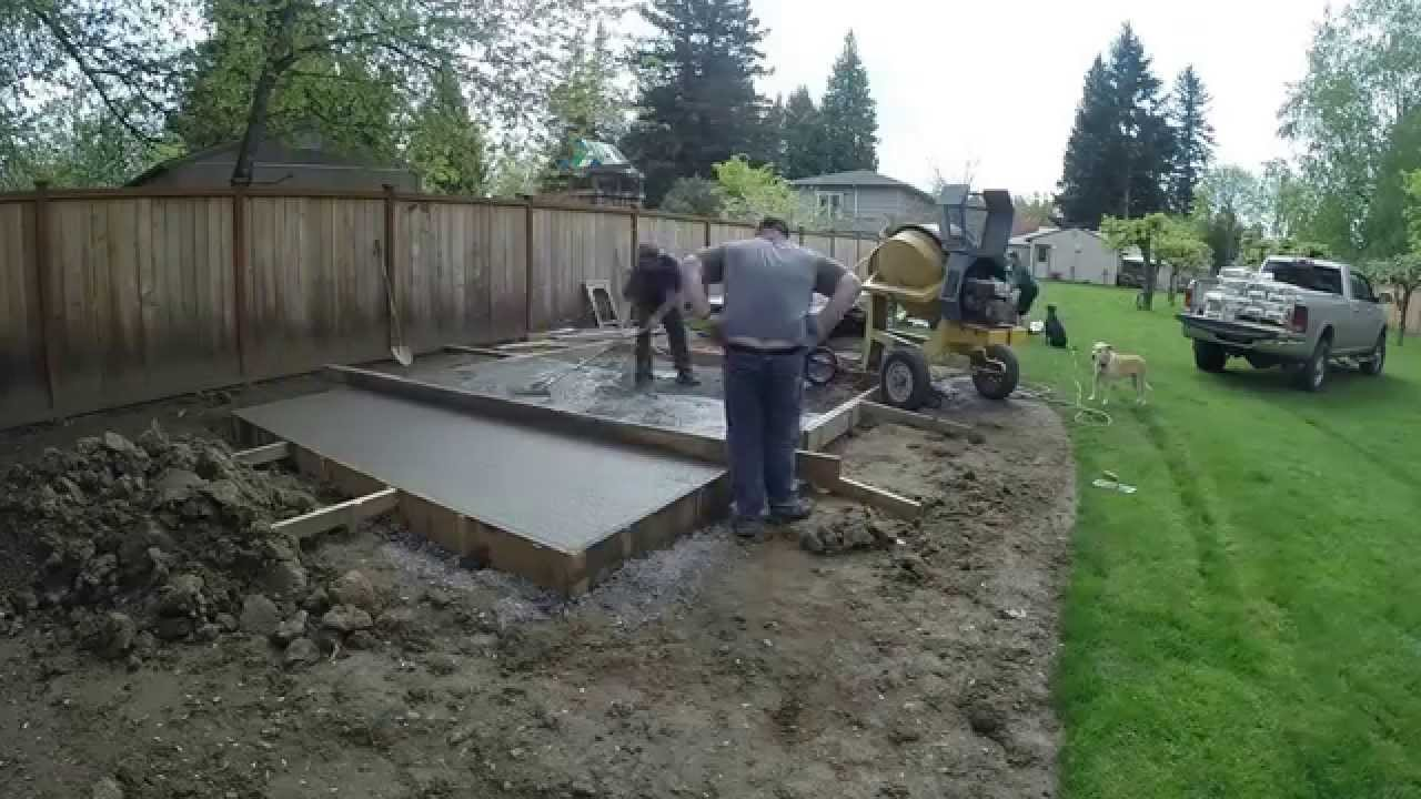 Pouring 6 Tons of Concrete using 80lb Bags - YouTube