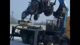 Погрузка трактора МТЗ-82 манипулятором на Камаз