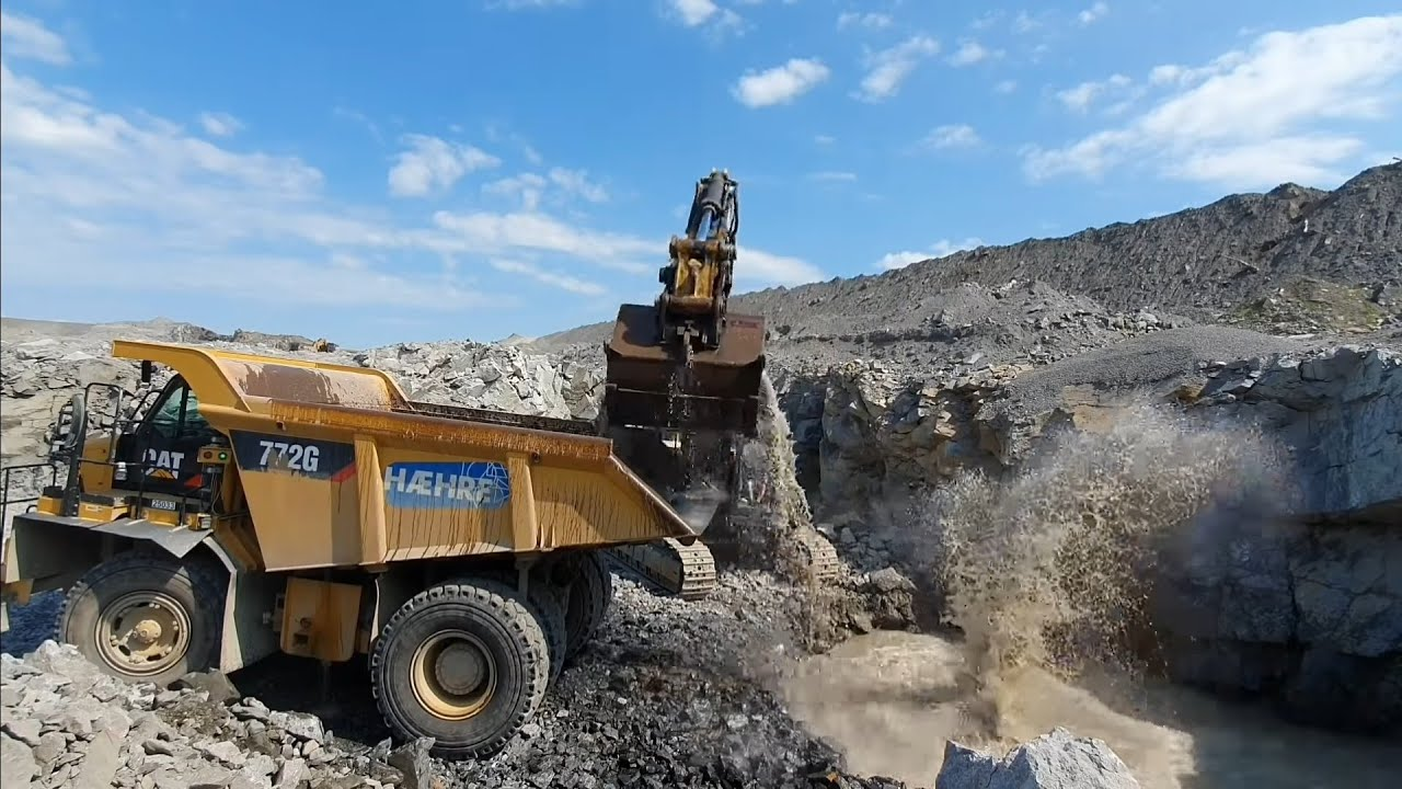 Rock and water! Cat 374 F LME toploading 772 G's! Outside and incab view, pure sound!!