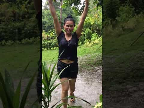 Filipina enjoying the rain