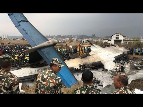 Passenger plane crashes off runway at Kathmandu airport in Nepal