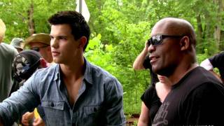 John Singleton Returns Thanks To Taylor Lautner