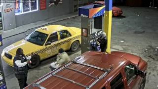 Two armed men caught on video robbing man at Detroit gas station