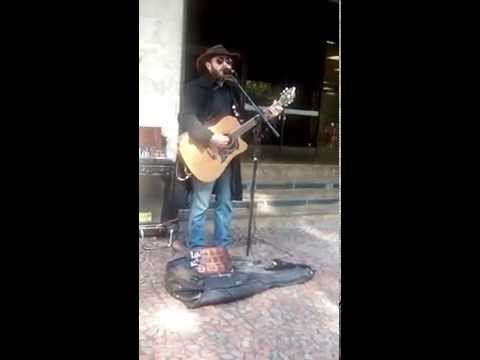 Street artist playing a lovely country song in Porto Alegre, Brazil