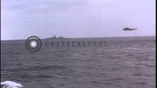 USS Charles P Cecil, USS Wallace Lind, SH-3A helicopter and S-2E plane during ASW...HD Stock Footage