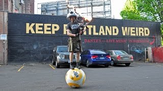 Man Balances on BB-8 Droid and Plays Star Wars on Flame Shooting Bagpipes