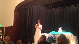 "Pam singing ""Happy Days Are Here Again"" at wedding reception"