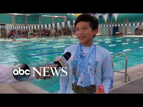 10-year-old breaks Michael Phelps' record in the 100-meter butterfly thumbnail
