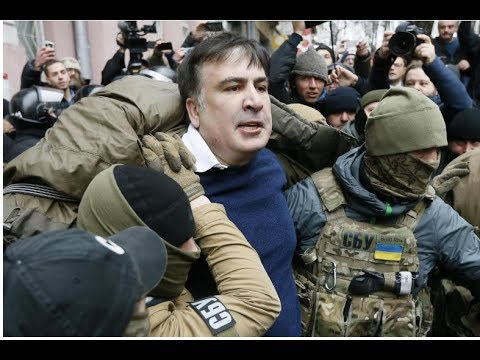 Supporters of former Georgian President Mikheil Saakashvili free him from a police van in Ukraine