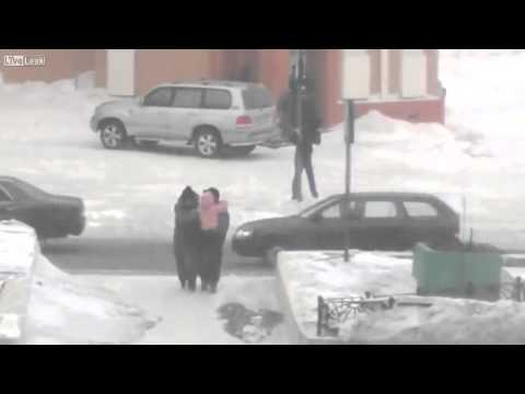 People try to cross the street in Norilsk Russia during winter storm.