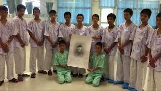 Boys trapped in Thailand cave mourn diver who died in rescue mission