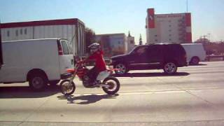 80 dirt bike on freeway..Only in L.A.