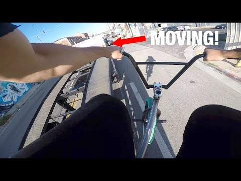 *INSANE* JUMPING OFF A MOVING FLATBED IN TRAFFIC! (BMX IN THE HOOD)