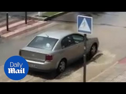 Cars drive through sewage in Costa Blanca holiday resort