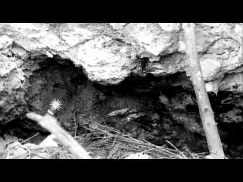 US soldiers around shaft lead to underground Japanese installation on Hill 153 in...HD Stock Footage