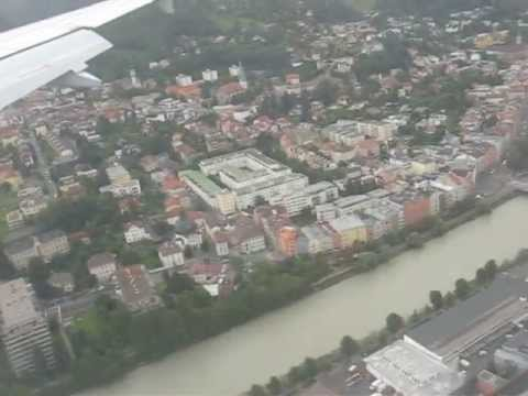 Landing at Innsbruck International Airport, flying over the Golden roof and St. James's Cathedral