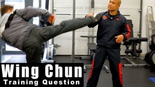 Wing Chun training - wing chun how to deal with high round kick.Q11