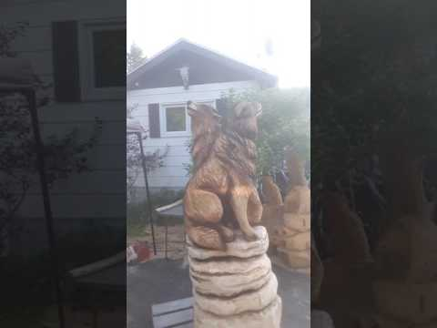 Chainsaw carved wolves by Joel Palmer 2017