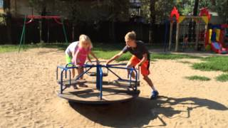 Spinning Carousel - Manually Powered Merry-go-round On A Playground In Russia