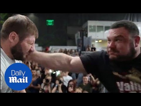 Men slap each other in Russian strength competition - Daily Mail