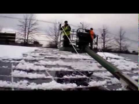 Cleaning Snow from Solar Array