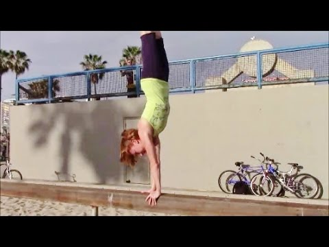 gymnastics drill handstand walks on balance beam with