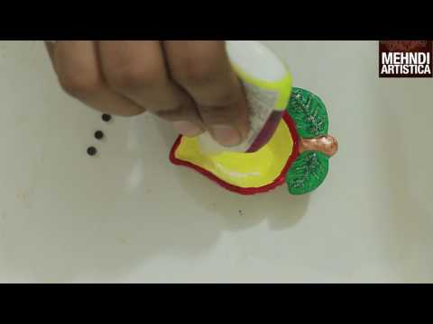 Studded mango diya decoration tips tricks for kids craft for Diya decoration youtube