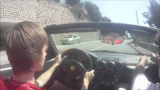 Teen driving Ferrari F430 spider above the hills of monaco.